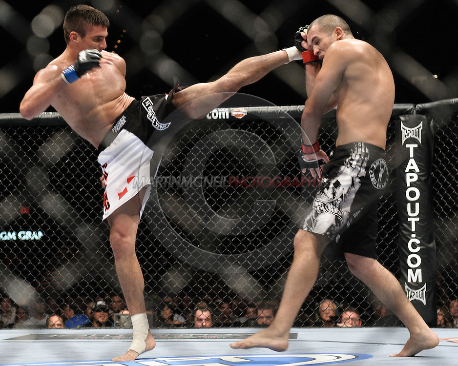 """LAS VEGAS, NEVADA, MAY 24, 2008: Goran Reljic (left) throws a kick to the head of Wilson Gouveia during """"UFC 84: Ill Will"""" inside the MGM Grand Garden Arena in Las Vegas"""