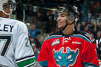KELOWNA, CANADA - MARCH 18: Tyrell Goulbourne #12 of Kelowna Rockets trash talks Evan Wardley #27 of Seattle Thunderbirds on March 18, 2015 at Prospera Place in Kelowna, British Columbia, Canada.  (Photo by Marissa Baecker/Shoot the Breeze)  *** Local Caption *** Tyrell Goulbourne; Evan Wardley;