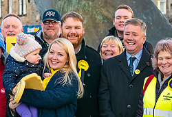 Pictured; Kelly and Isla (nearly 2years), wife & daughter of Owen Thompson, Owen Thompson SNP candidate for Midlothian and Keith Brown, SNP Depute Leader <br /> <br /> Loanhead, Midlothian, Scotland, United Kingdom, 18 November 2019. General Election campaigning:  SNP Depute Leader Keith Brown MSP joins Owen Thomson, SNP candidate for Midlothian, on the campaign trail at Fountain Green, Loanhead.<br /> <br /> Sally Anderson | EdinburghElitemedia.co.uk