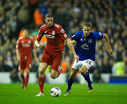 LIVERPOOL, ENGLAND - Tuesday, March 13, 2012: Liverpool's Andy Carroll in action against Everton's Jack Rodwell during the Premiership match at Anfield. (Pic by David Rawcliffe/Propaganda)