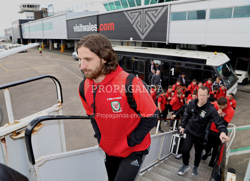 CARDIFF, WALES - Thursday, March 23, 2017: Wales' Joe Allen boards the team plane as the squad depart Cardiff Airport to fly to Dublin ahead of the 2018 FIFA World Cup Qualifying Group D match against Republic of Ireland. (Pic by David Rawcliffe/Propaganda)