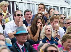 lDuke and Duchess of Cambridge and Prince Harry watching Zara Phillips competing  at  the show jumping event at the London 2012 Olympics , Tuesday 31st July 2012 Photo by: i-Images