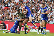 Warrington's Jack Hughes and Joe Westerman stop Hull's Mark Minichiello during the Challenge Cup Final 2016 match between Warrington Wolves and Hull FC at Wembley Stadium, London, England on 27 August 2016. Photo by Craig Galloway.
