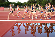 May 2, 2019; Stanford, CA, USA; Runners are reflected in the water jump in the women's  steeplechase during the 24th Payton Jordan Invitational at Cobb Track & Angell Field.