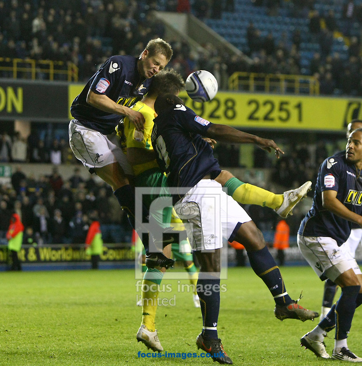 London - Tuesday November 9th, 2010: Elliot Ward of Norwich is beaten in the air by the Millwall defence during the Npower Championship match at The New Den, London. (Pic by Paul Chesterton/Focus Images)