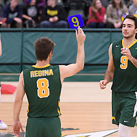 3rd year outside hitter Dalton Wolfe (9) subs in for 4th year Dylan Smith (8) of the Regina Cougars  during Men's Volleyball home game on November 18 at Centre for Kinesiology, Health and Sport. Credit: /Arthur Images