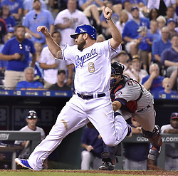 June 30, 2017 - Kansas City, MO, USA - The Kansas City Royals' Mike Moustakas scores before the tag from Minnesota Twins catcher Jason Castro on a sacrifice fly by Alex Gordon in the eighth inning at Kauffman Stadium in Kansas City, Mo., on Friday, June 30, 2017. (Credit Image: © John Sleezer/TNS via ZUMA Wire)