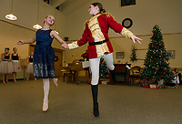 "Josephina Scoog as ""Clara"" and Eliza Carter as the ""Nutcracker"" perform with the Lakes Region Dance Company for the Taylor Home on Monday evening.  (Karen Bobotas/for the Laconia Daily Sun)"