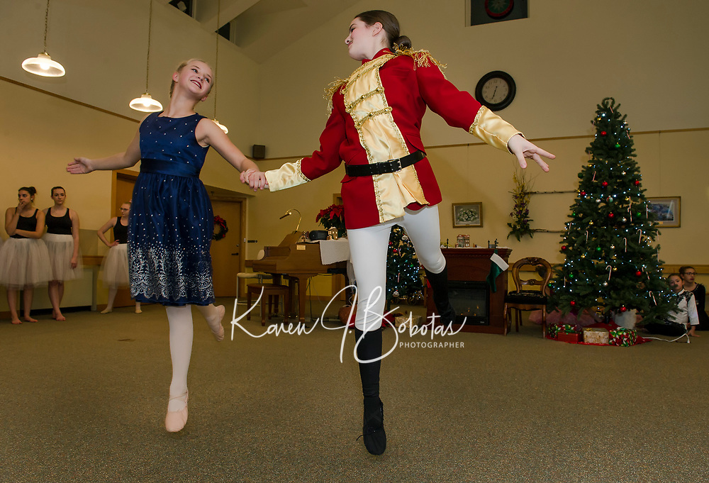 """Josephina Scoog as """"Clara"""" and Eliza Carter as the """"Nutcracker"""" perform with the Lakes Region Dance Company for the Taylor Home on Monday evening.  (Karen Bobotas/for the Laconia Daily Sun)"""