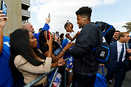 Kentucky Wildcats defensive end Calvin Taylor Jr. (91), right hugs his niece Dallas Williams while he and the team enter Kroger Field during the Catwalk in Lexington, Ky., Saturday, Sept. 7, 2019.