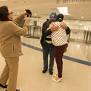 Pedro Ravelo of Cuba is greeted by his daughter Dannys Mary Ravelo as his wife Daniella Fiallo Jorge shoots video after he arrived at Miami airport, Florida, U.S. February 23, 2018. Picture taken February 23, 2018.  REUTERS/Angel Valentin