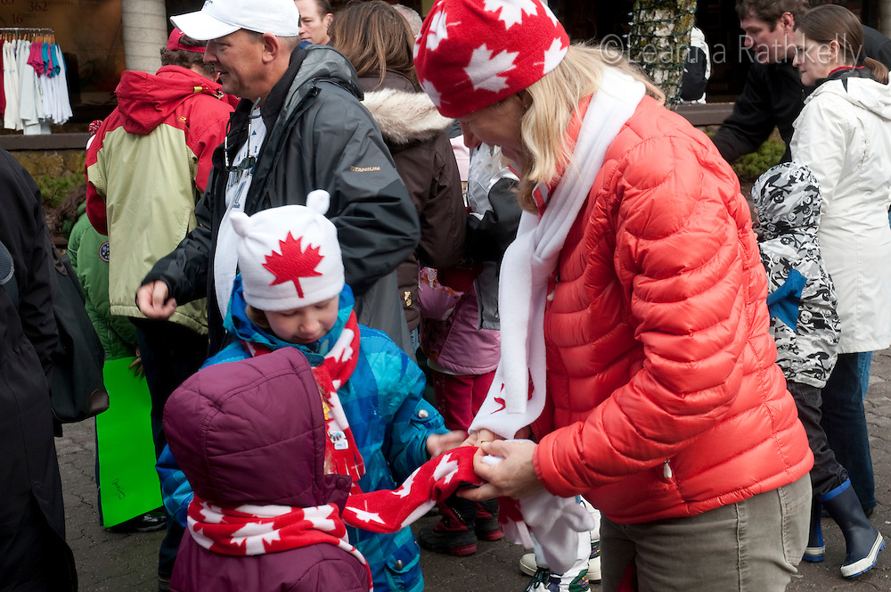Visitors enjoy trading pins, tatoos, and walking through the village during the 2010 Olympic Winter Games.