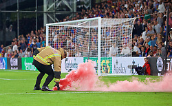 LONDON, ENGLAND - Monday, August 20, 2018: A smoke bomb is removed from the pitch during the FA Premier League match between Crystal Palace and Liverpool FC at Selhurst Park. (Pic by David Rawcliffe/Propaganda)