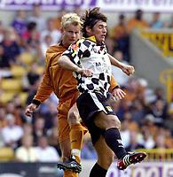 Photo: Greig Cowie, Digitalsport<br /> 08/08/2003.<br /> Pre-Season Football Friendly. Wolverhampton Wanderers v Boavista.<br /> Steffen Iversen jumps with Ricardo Silva