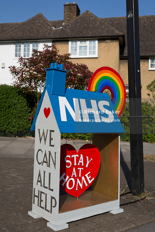 As the UK government's lockdown restrictions during the Coronavirus pandemic continues, and number of UK reported cases rose to 138,078 with a total now of 18,738 deaths, a locally constructed representation of an NHS house, a model of acknowledgement and support for NHS (National Health Service) care workers, outside a 'Homes For Heroes' (for WW1 veterans) at the top of the Casino Avenue estate in Herne Hill, on 23rd April 2020, in London, England.