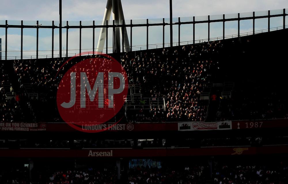 Arsenal Fans in sun light  - Mandatory by-line: Joe Meredith/JMP - 25/07/2015 - SPORT - FOOTBALL - London,England - Emirates Stadium - Arsenal v Lyon - Emirates Cup