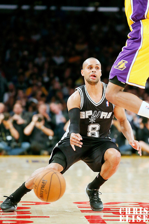 19 March 2014: San Antonio Spurs guard Patty Mills (8) makes a pass during the San Antonio Spurs 125-109 victory over the Los Angeles Lakers at the Staples Center, Los Angeles, California, USA.
