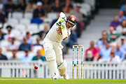 Dean Elgar of Surrey hits the ball to the boundary for four runs during the Specsavers County Champ Div 1 match between Surrey County Cricket Club and Kent County Cricket Club at the Kia Oval, Kennington, United Kingdom on 7 July 2019.