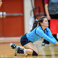 Ganado Hornet Dawn McNabb dives (5) to volley to the Window Rock Scouts at Ganado High School in Burnside Tuesday.