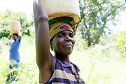 Nellie Munesaka - 2nd wife of the headman collects water. Haboombe Village. A Day in the Life..WaterAid water industry supporters trip to Monze, Zambia. ..February 2012..© WaterAid / Zute  Lightfoot.