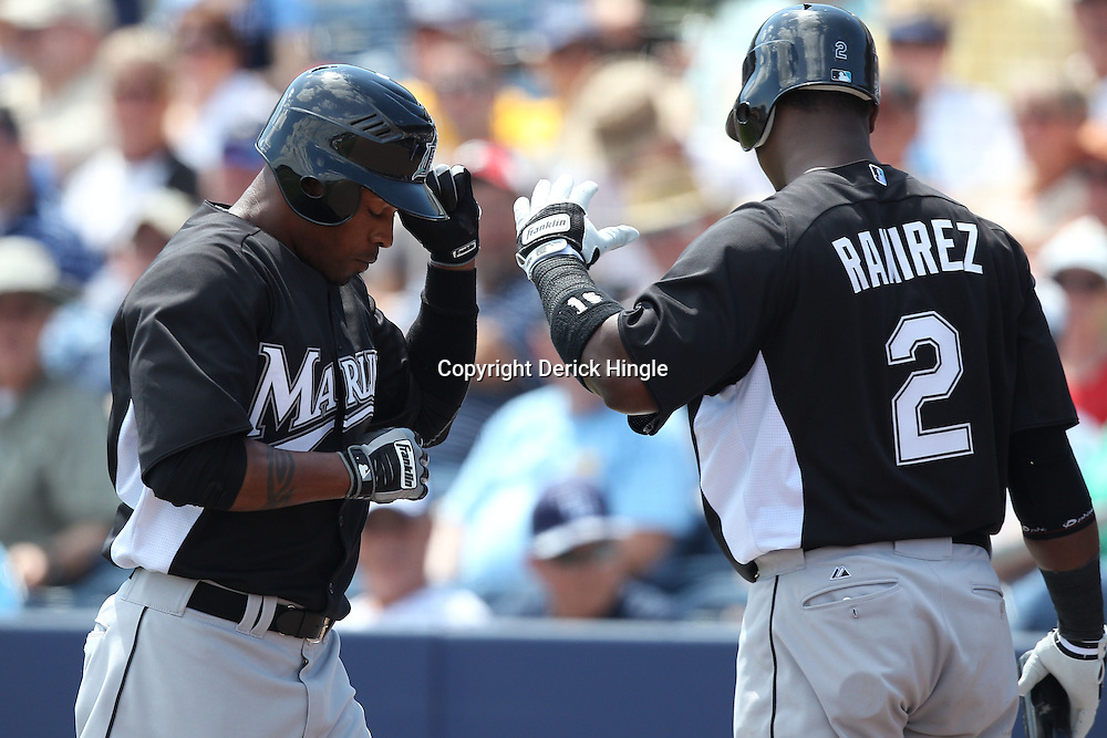March 15, 2011; Port Charlotte, FL, USA; Florida Marlins center fielder Dewayne Wise (10)  is greeted by shortstop Hanley Ramirez (2) following a solo homerun in the first inning during a spring training exhibition game against the Tampa Bay Rays at Charlotte Sports Park.   Mandatory Credit: Derick E. Hingle