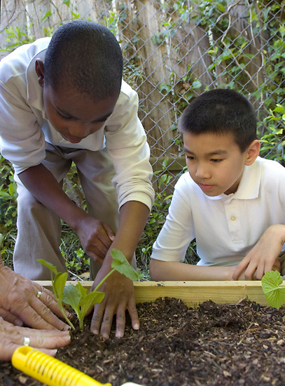 Linda Beasley helps James Turner, 9, and Noble Hamrang, 8, plant a garden during the Junior Youth Empowerment program on Tuesday, April 12, 2011 at  Christ Episcopal Church. The non denominational program, which is a collaboration of Christ Episcopal Church and Baha'i, attempts to teach spirituality and morals to students through lessons and hands on activities. James is the son of Aisha Turner. Noble is the son of Rezvon and Leah Hamrang. (Bryant Hawkins/The Vicksburg Post)