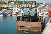 Traditional small trawler vessel in the harbour of fishing port of Newlyn, Cornwall, England, UK