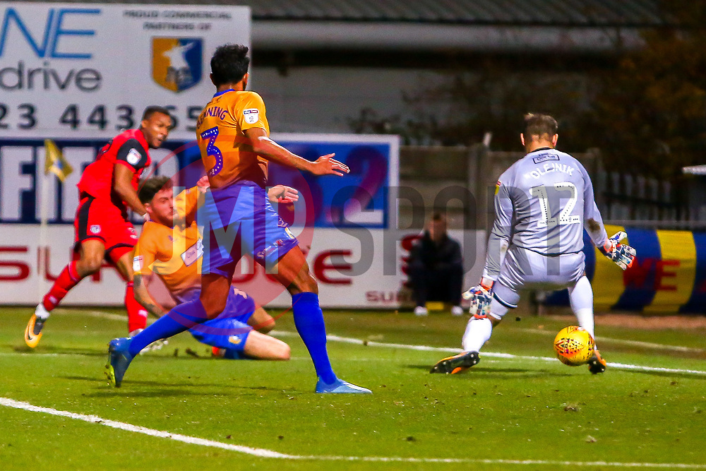 Wes Thomas of Grimsby Town's shot goes through the legs of Robert Olejnik of Mansfield Town to give Grimsby Town the lead - Mandatory by-line: Ryan Crockett/JMP - 06/11/2018 - FOOTBALL - One Call Stadium - Mansfield, England - Mansfield Town v Grimsby Town - Sky Bet League Two