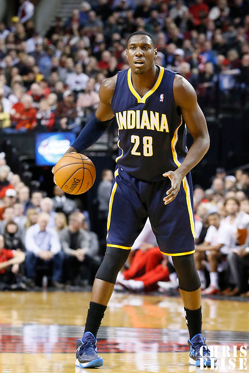 02 December 2013: Indiana Pacers center Ian Mahinmi (28) looks to pass the ball during the Portland Trail Blazers 106-102 victory over the Indiana Pacers at the Moda Center, Portland, Oregon, USA.