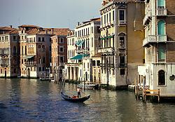 Venice, Italy:  A single gondola makes its way along the Grand Canal.
