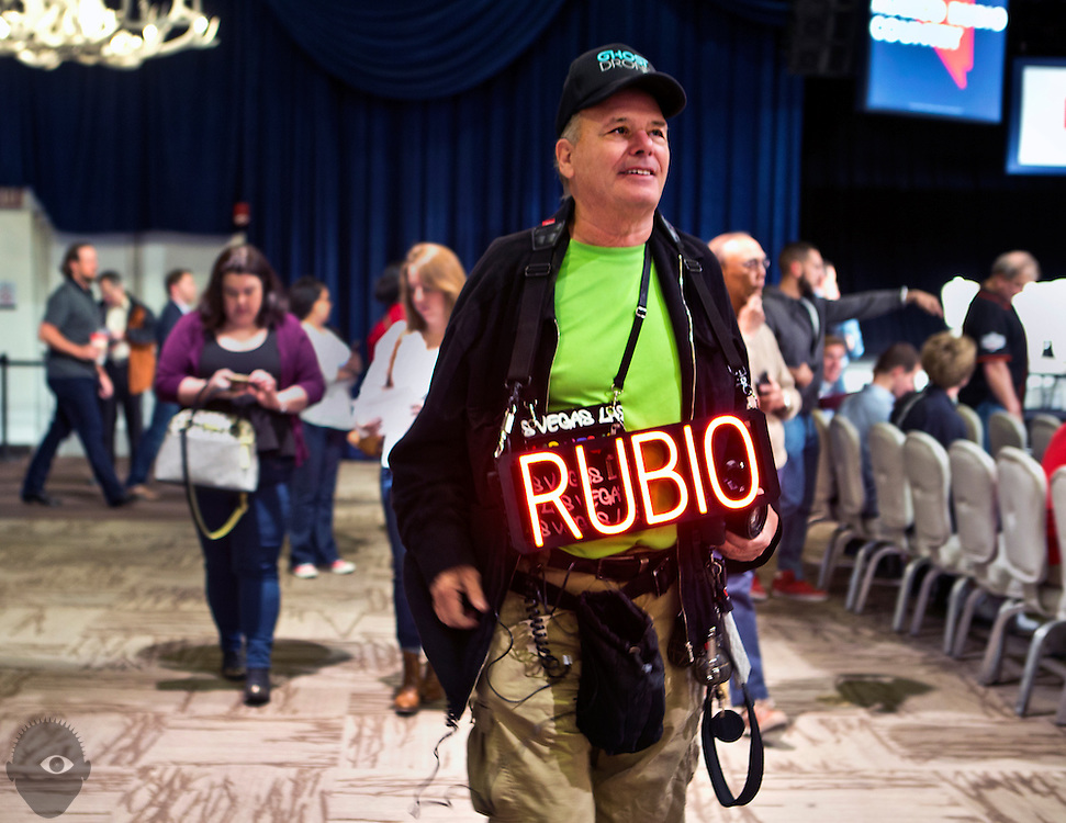 John Mendonca sports a homemade neon sign while attending a rally for Republican presidential candidate Marco Rubio in Las Vegas at the Silverton Casino ahead of the Nevada caucuses in the evening on Tuesday, February 23, 2016.   L.E. Baskow