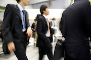 young business commuters Tokyo Japan