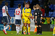 Nesta Guinness-Walker of Wimbledon shakes hands with Referee Marc Edwards at full time during the EFL Sky Bet League 1 match between Bolton Wanderers and AFC Wimbledon at the University of  Bolton Stadium, Bolton, England on 7 December 2019.