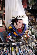 """An Elvis bust amongst Hawaiian shirts (aka """"aloha shirts"""") for sale at Bailey's Antiques and Aloha Shirts store in Honolulu, Hawaii"""