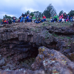082313       Brian Leddy<br /> Spectators watch bats emerge from Bat Cave at El Calderon area of El Malpais National Monument Friday evening. Every Friday during the summer, the National Park Service hosts a ranger hike to watch over 5000 bats emerge from the cave at dusk.