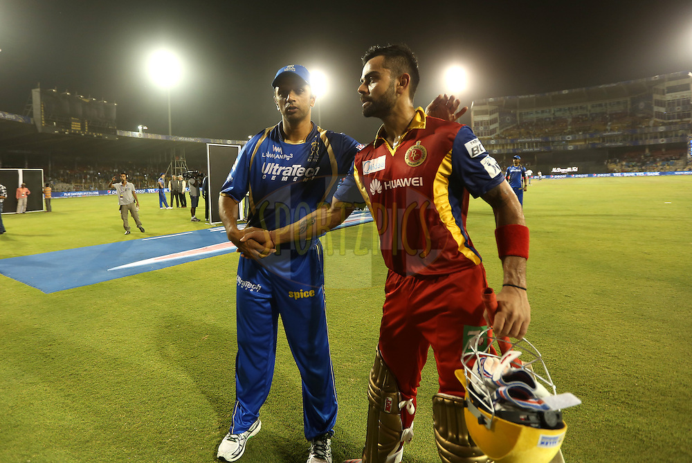 Royal Challengers Bangalore captain Virat Kohli shake hands with Rajasthan Royals mentor Rahul Dravid after winning the  match 22 of the Pepsi IPL 2015 (Indian Premier League) between The Rajasthan Royals and The Royal Challengers Bangalore held at the Sardar Patel Stadium in Ahmedabad , India on the 24th April 2015.<br /> <br /> Photo by:  Sandeep Shetty / SPORTZPICS / IPL