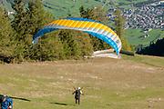 Paragliding from the summit of Elfer mountain down to Neustift im Stubaital, Tyrol, Austria