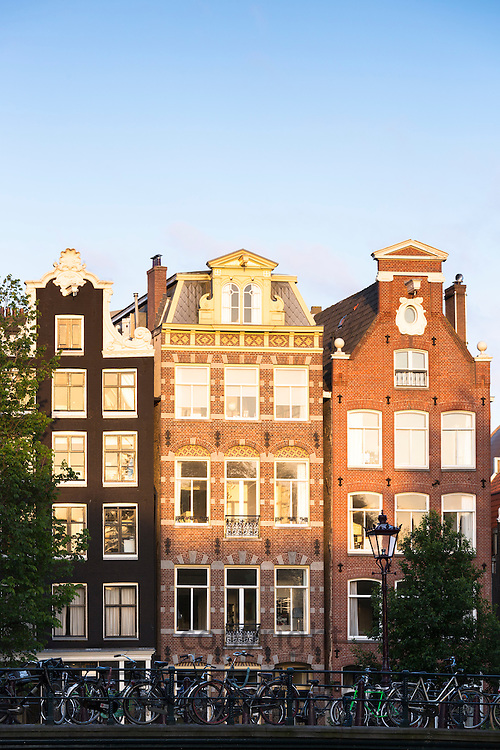 Gables of traditional Dutch architecture of canalside buildings in Prinsengracht, Amsterdam, Holland