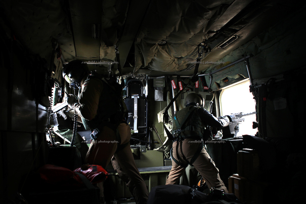 A CH-53 helicopter of the german ISAF forces above norther Afghanistan. Two door gunner cover both sides.