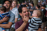A man dances with a young boy to the music of The Devil Makes Three at Celebrate Brooklyn. The concerts are free, and take place three nights a week throughout the summer.