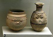 Two Egyptian pots depicting faces of Bes. circa 660-300BC