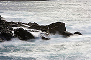Waves crashing on the rocks at Point Lobos on the Central Coast of California.