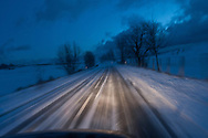 snow on a road in winter at night Cevennes. landscape