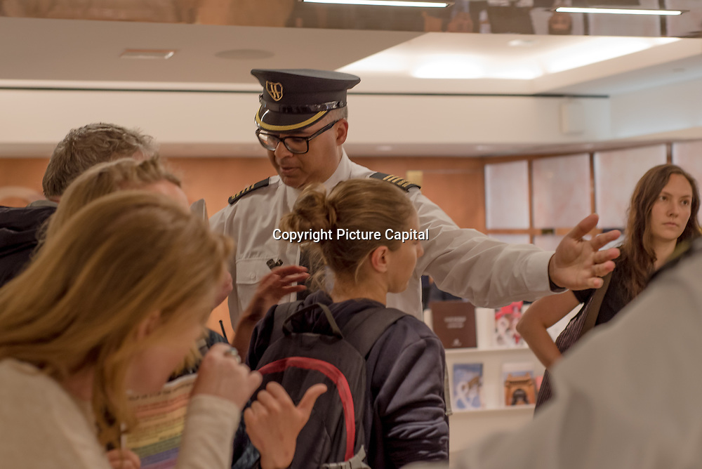 TRJFP at All Hallows' - Rainbow Junktion hold a protest to demand Qatar Airways stop G's deportation a 22-year-old lesbian, is at risk of anti-LGBT persecution and violence if sent back to Uganda by the Home Office at Qatar Airlines Ticket Desk inside Harrods. The security staff was heavy-handed, trying to rip the banners out of the hands of the protestors and escort them out on 29 May 2018.