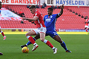 Barnsley FC midfielder Harvey Barnes (15) and Birmingham City midfielder David Davis (26)  during the EFL Sky Bet Championship match between Barnsley and Birmingham City at Oakwell, Barnsley, England on 4 November 2017. Photo by Ian Lyall.