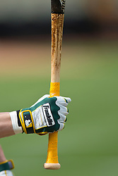 OAKLAND, CA - JUNE 14:  Detailed view of Josh Reddick #16 of the Oakland Athletics holding a baseball bat wearing a batting glove during batting practice before the game against the New York Yankees at O.co Coliseum on June 14, 2014 in Oakland, California. The Oakland Athletics defeated the New York Yankees 5-1.  (Photo by Jason O. Watson/Getty Images) *** Local Caption *** Josh Reddick
