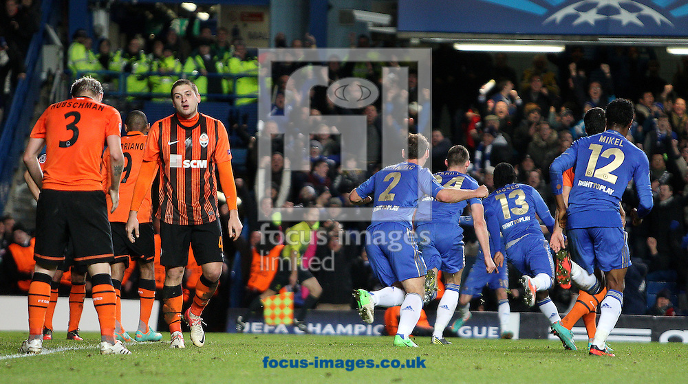 Picture by Paul Terry/Focus Images Ltd +44 7545 642257.07/11/2012.Victor Moses (3rd R) of Chelsea celebrates with team mates as  Shakhtar Donetsk players show their dejection during the UEFA Champions League match at Stamford Bridge, London.