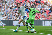 James Norwood (Tranmere Rovers) almost gets through the middle of the Forest Green Rovers' defence, but for a timely interception by Drissa Traore (Forest Green Rovers) during the Vanarama National League Play Off Final match between Tranmere Rovers and Forest Green Rovers at Wembley Stadium, London, England on 14 May 2017. Photo by Mark P Doherty.