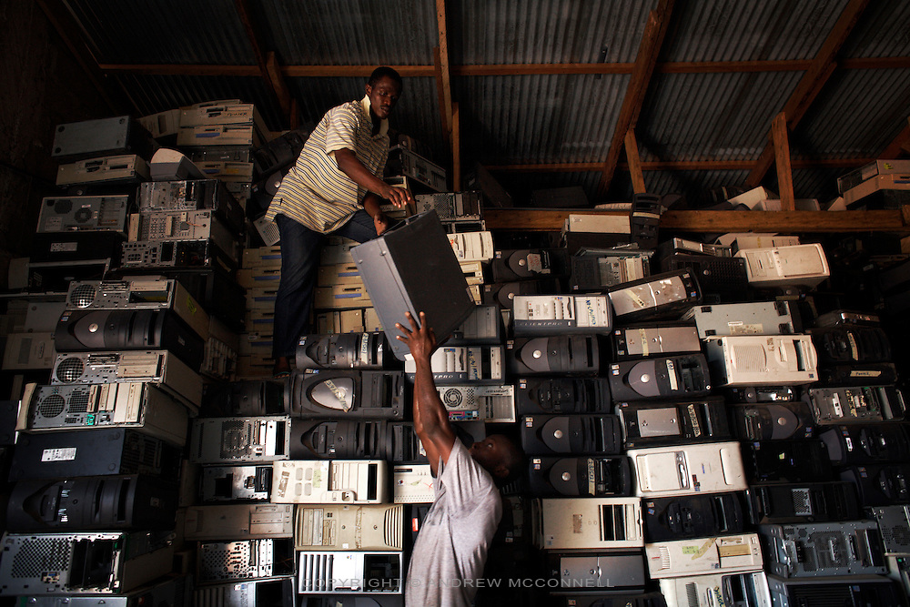 Computer hard drives are stacked high at a importers warehouse in Accra, Ghana. The majority of them are not working and will be scrapped. Containers arriving in Ghana with computers are often labelled second hand goods so as to bypass international laws, but in reality as much as 80% of the equipment will be obsolete or broken.