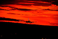 ©Randy Vanderveen© 2007 Randy Vanderveen, all rights reserved.Grande Prairie, Alberta.A Westjet 727 heads in on final approach to the Grande Prairie Regional Airport as it is silhouetted against the colour of a sunset.